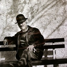 "View ""Elderly man on park bench in Portugal"""